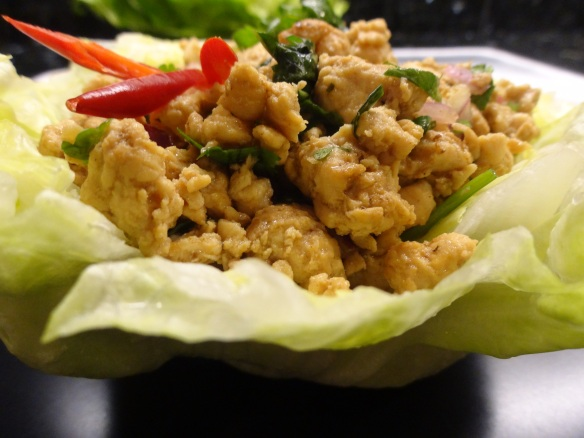 Chopped chicken in lettuce cups